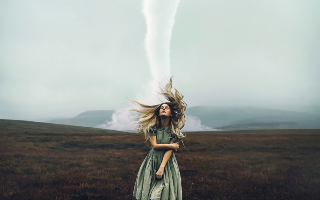 a-girl-standing-in-front-of-a-tornado